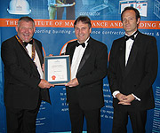 Mike Parrett and Series Producer, Anthony Levene receiving their award from Steve Dunford FIMBM, IMBM President